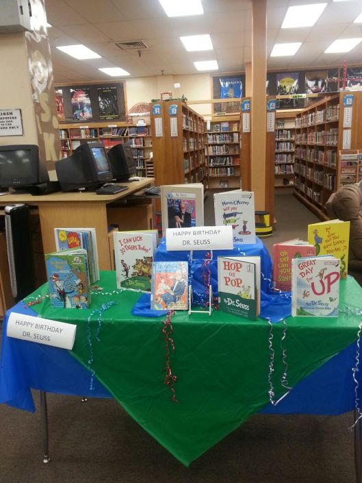 NFL Moms purchase books for each event and donate to school reading programs